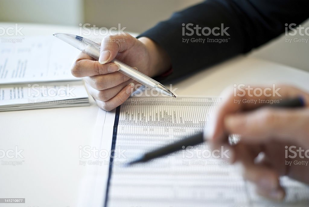 Business people analyzing a report royalty-free stock photo