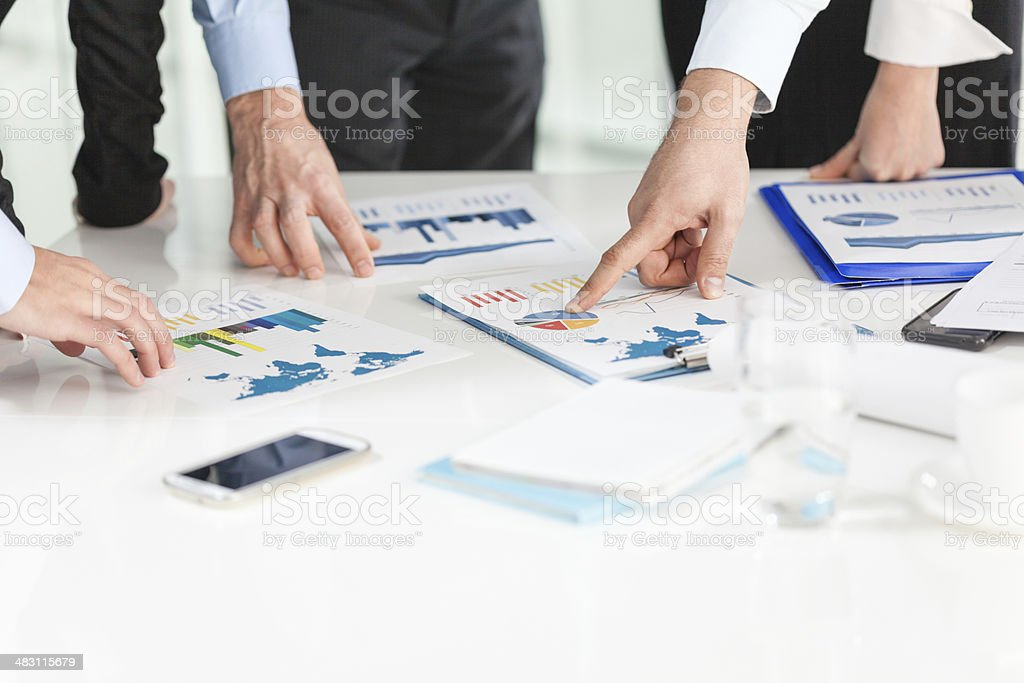 Business people analyzing charts stock photo