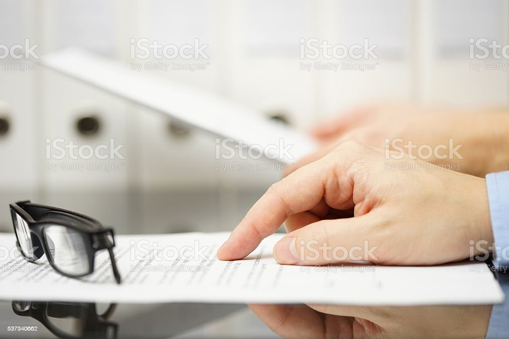 business people analyzing legal or financial document stock photo
