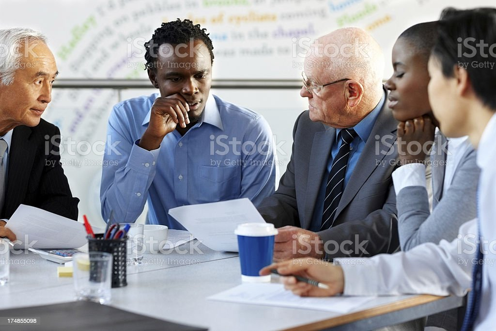 Business people analyzing statistic royalty-free stock photo