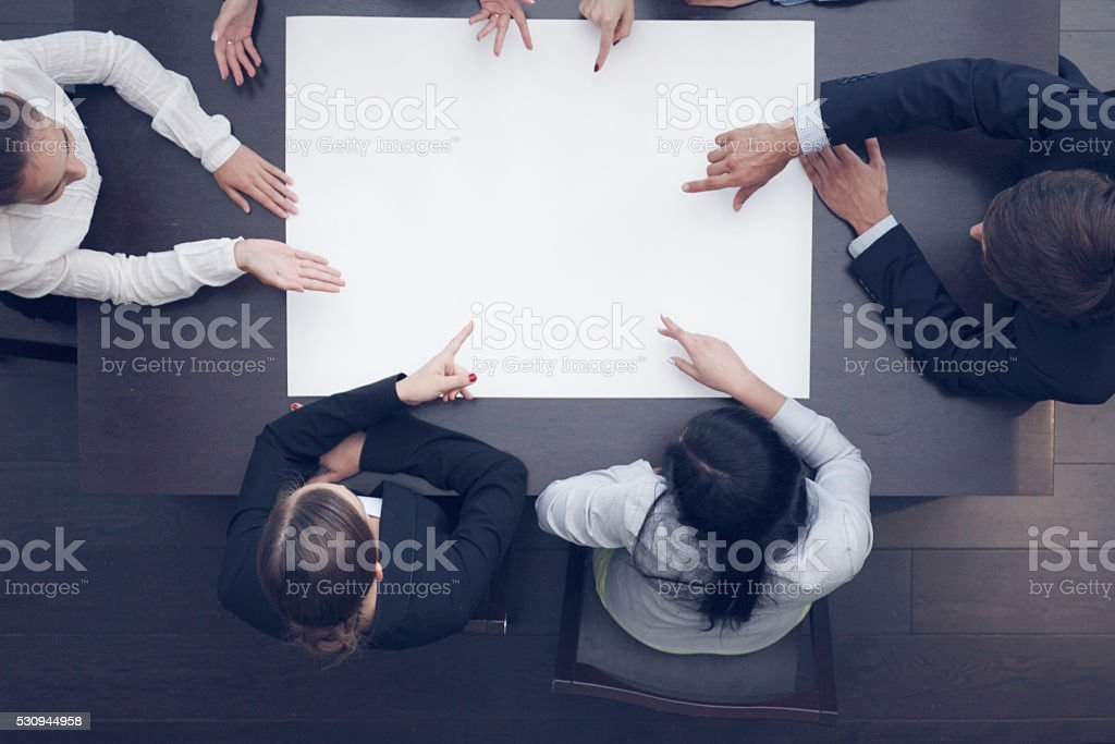 Business people and blank paper stock photo