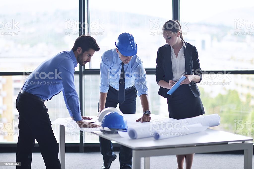 business people and engineers on meeting stock photo