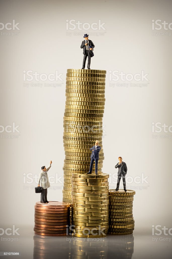 Business people and euro coin piles stock photo