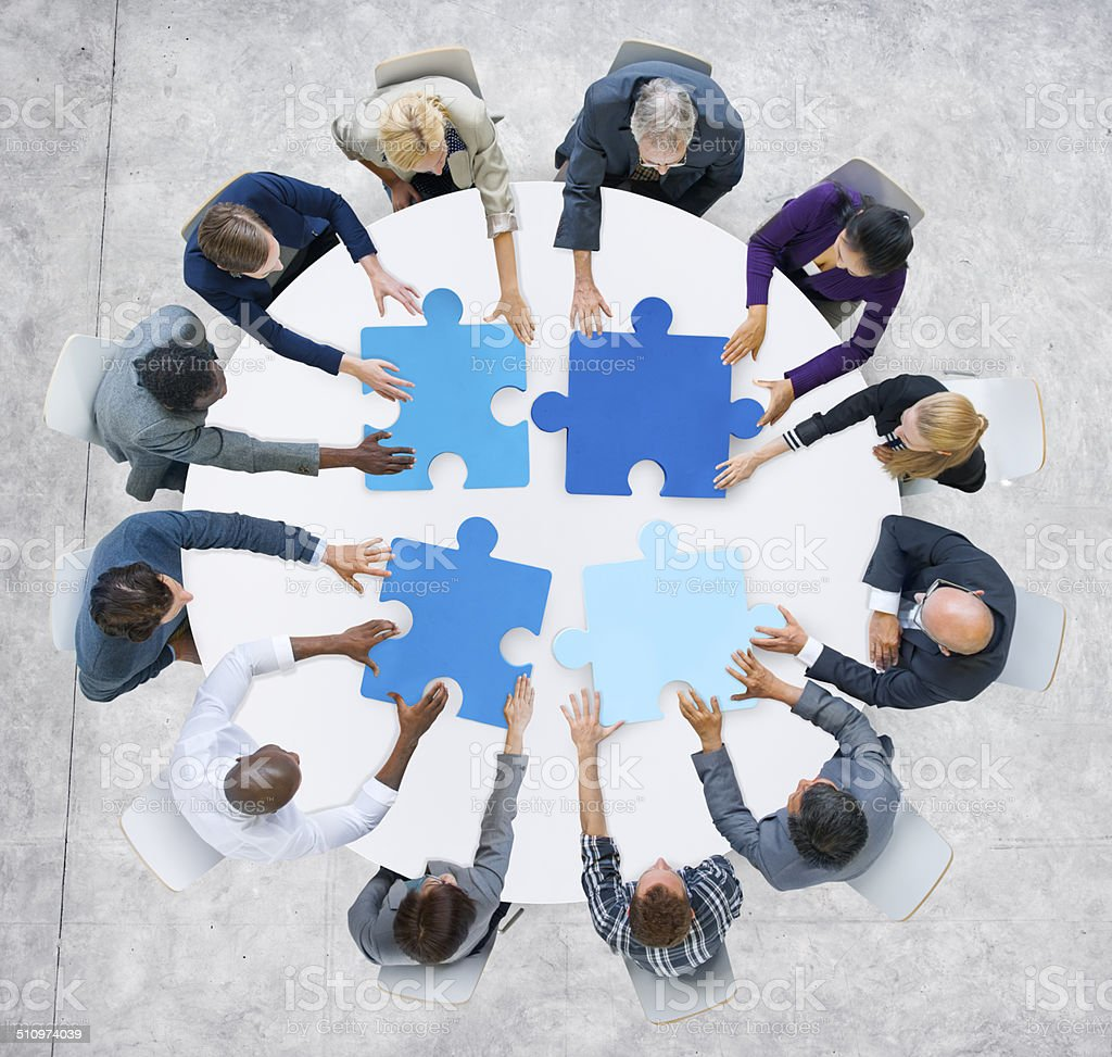 Business People and Jigsaw Puzzle Pieces stock photo