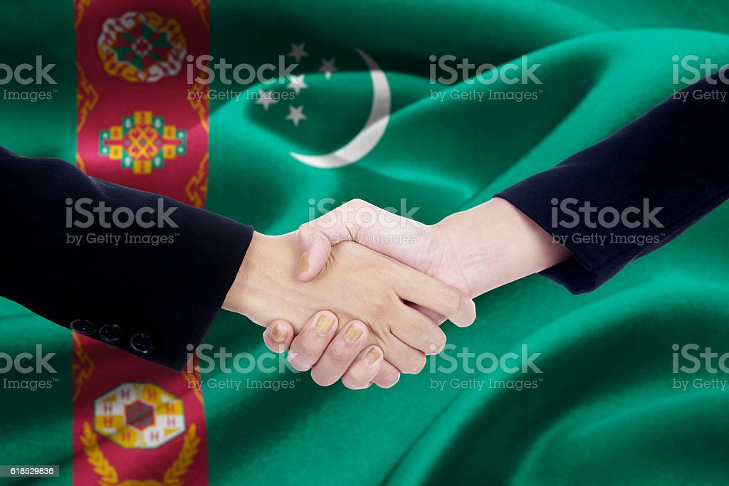 Business people and Turkmenistan flag stock photo