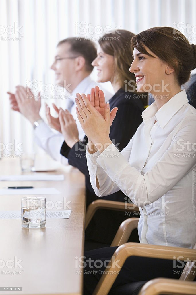 Business people applauding at a meeting royalty-free stock photo