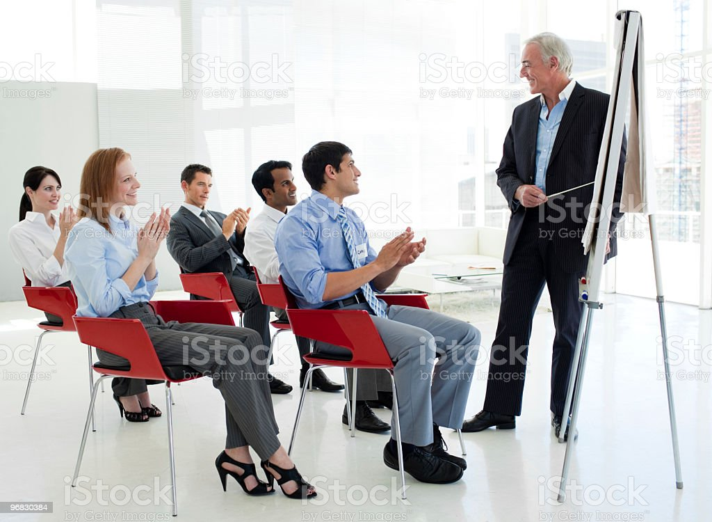 Business people applauding at the end of a conference royalty-free stock photo