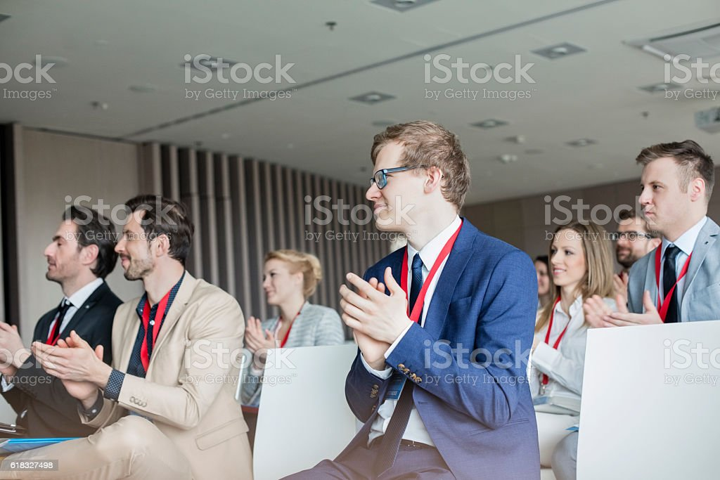 Business people applauding during seminar stock photo