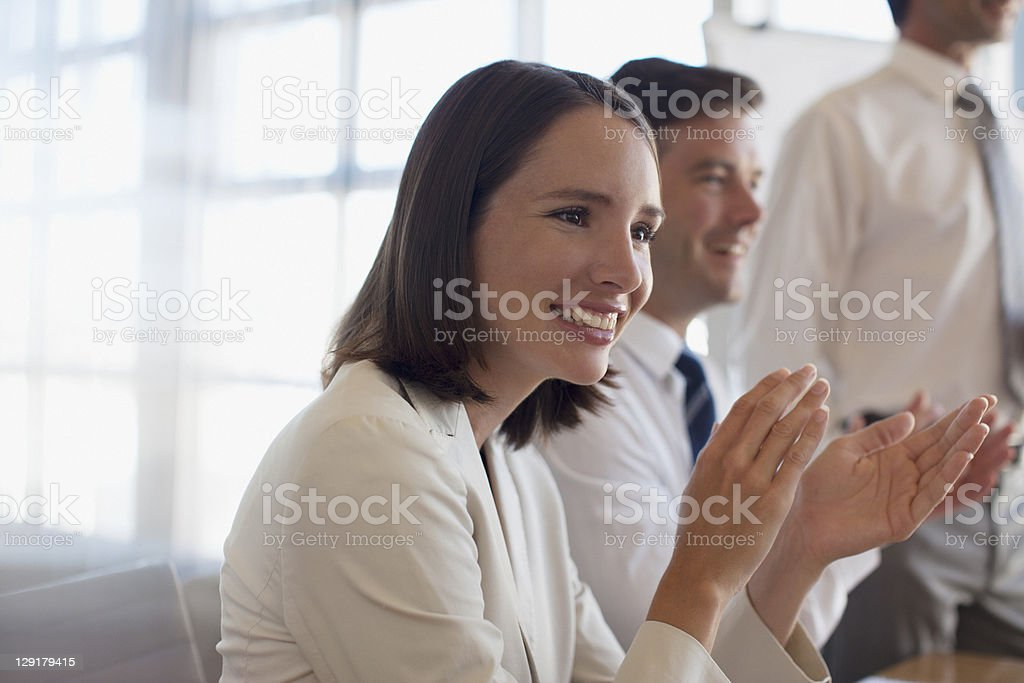 Business people applauding for presentation royalty-free stock photo