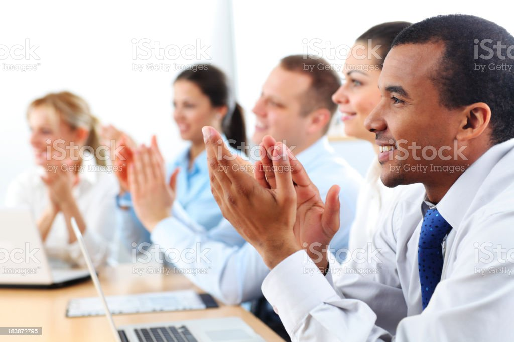 Business people applauding on a meeting. royalty-free stock photo
