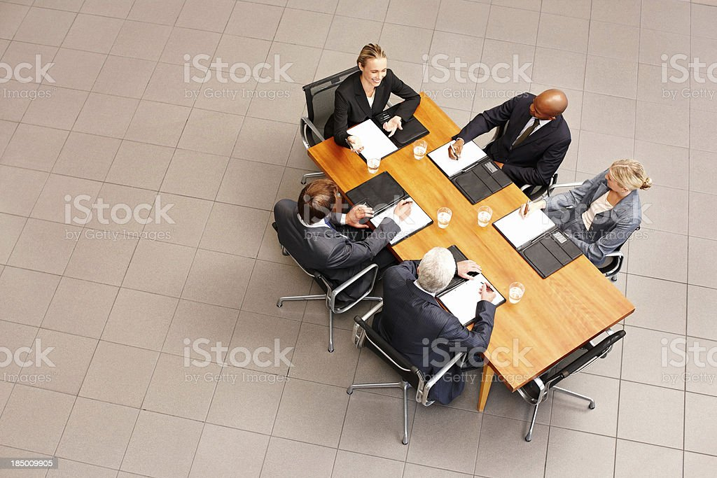 Business People at a Conference Table stock photo