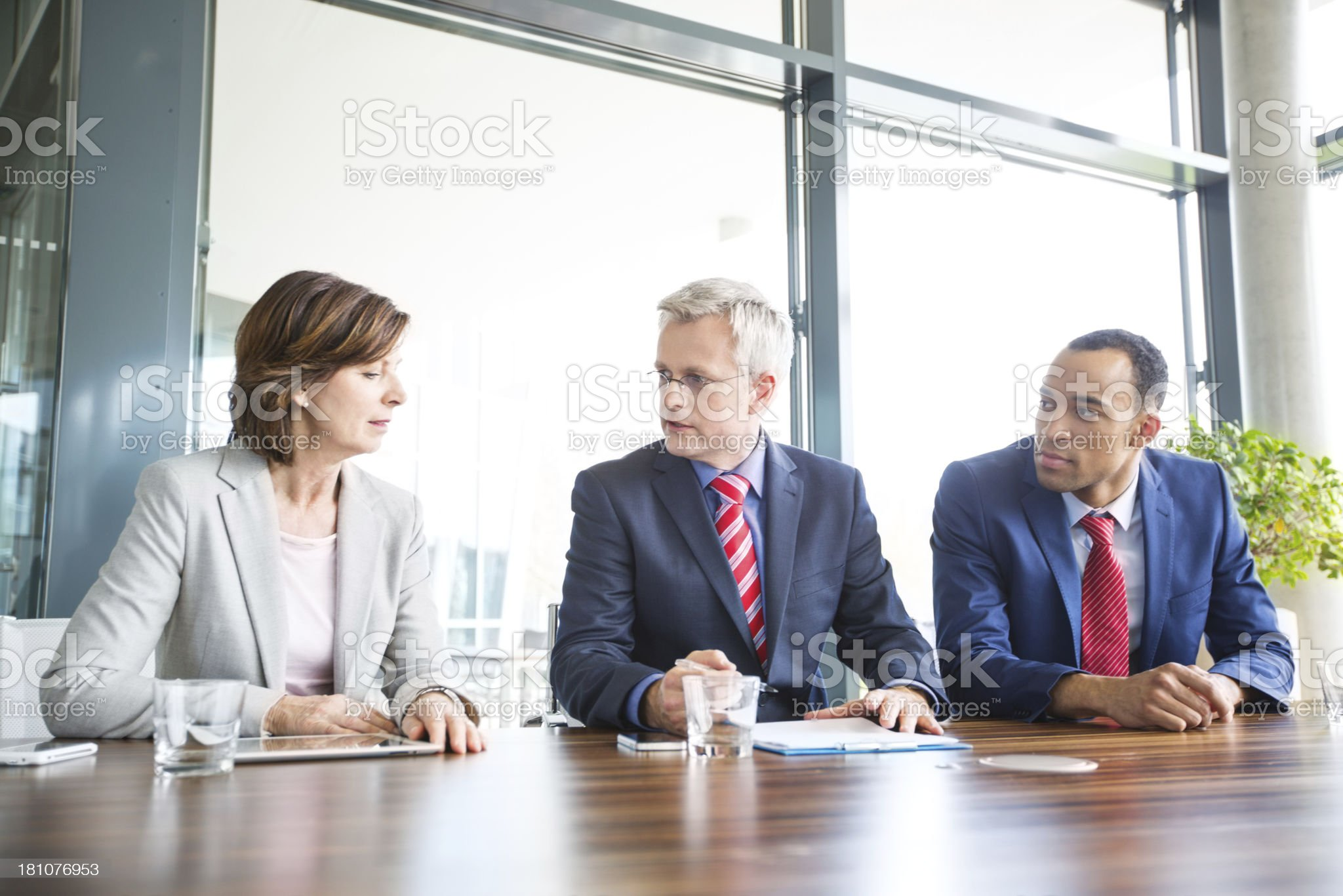 Business people at a meeting conversing royalty-free stock photo