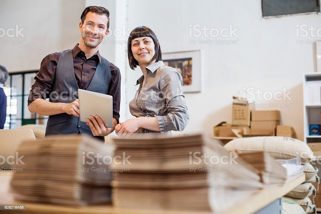 Business people at coffee storage room stock photo