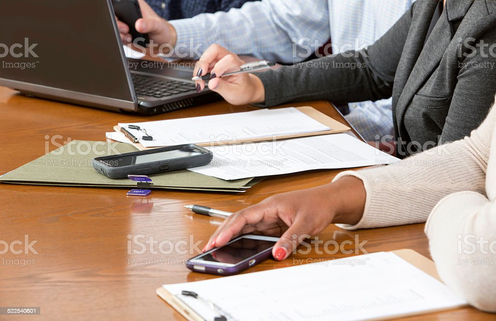 Business people at conference table during a meeting stock photo