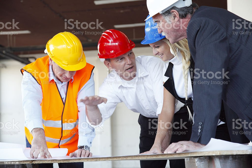 Business  people at construction site royalty-free stock photo
