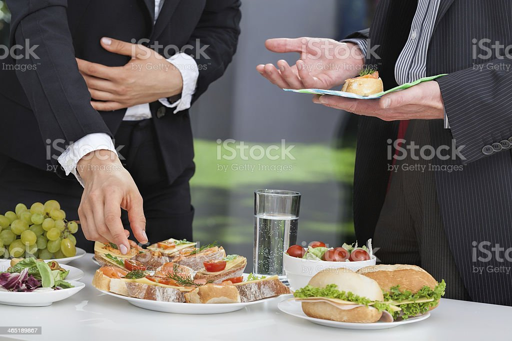Business people at lunch buffet stock photo