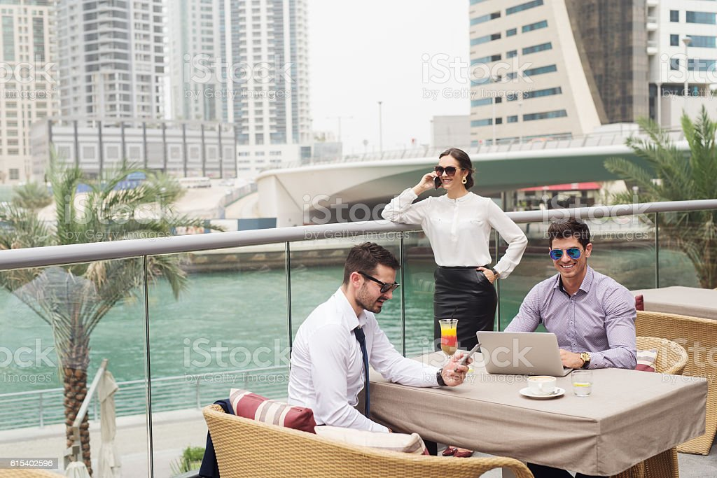 Business people at meeting in Dubai Marina. stock photo
