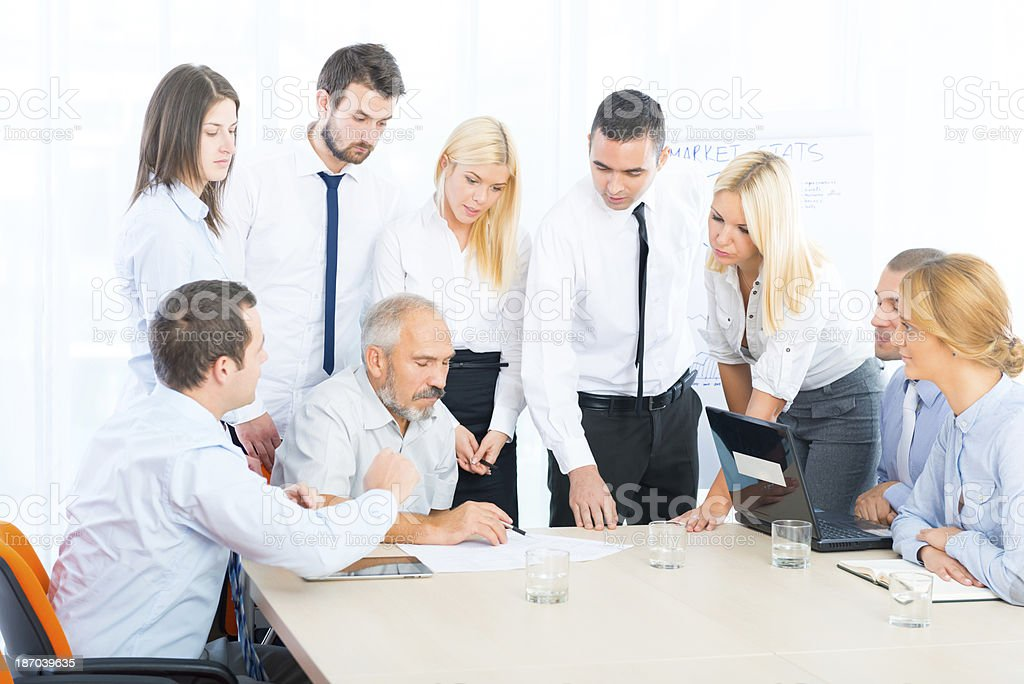 Business people at office meeting,discussing royalty-free stock photo
