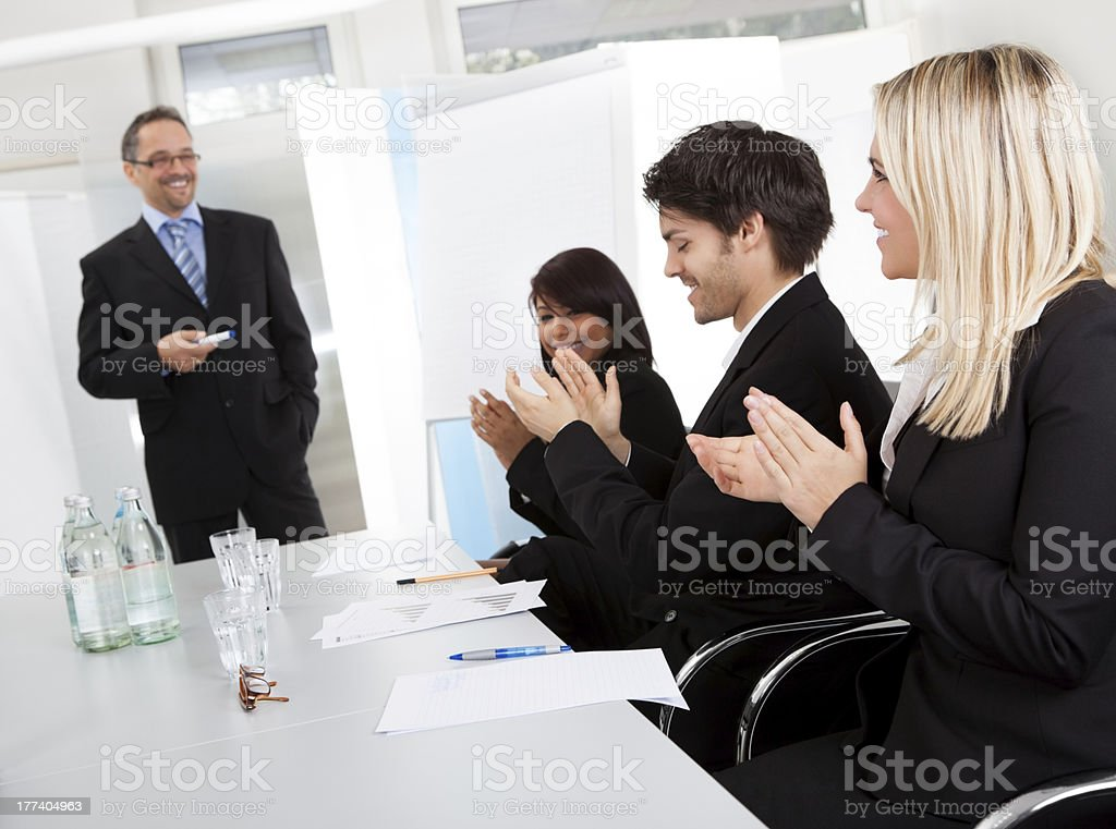 Business people at presentation applauding royalty-free stock photo