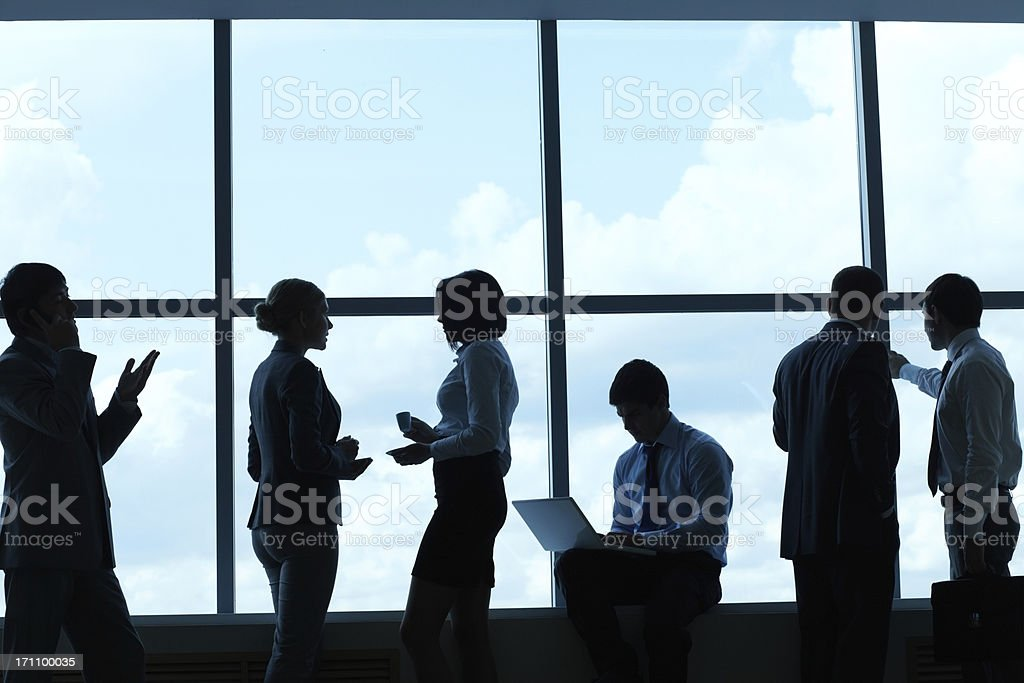 Business people at window royalty-free stock photo