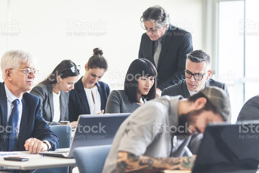 Business people attending a seminar stock photo