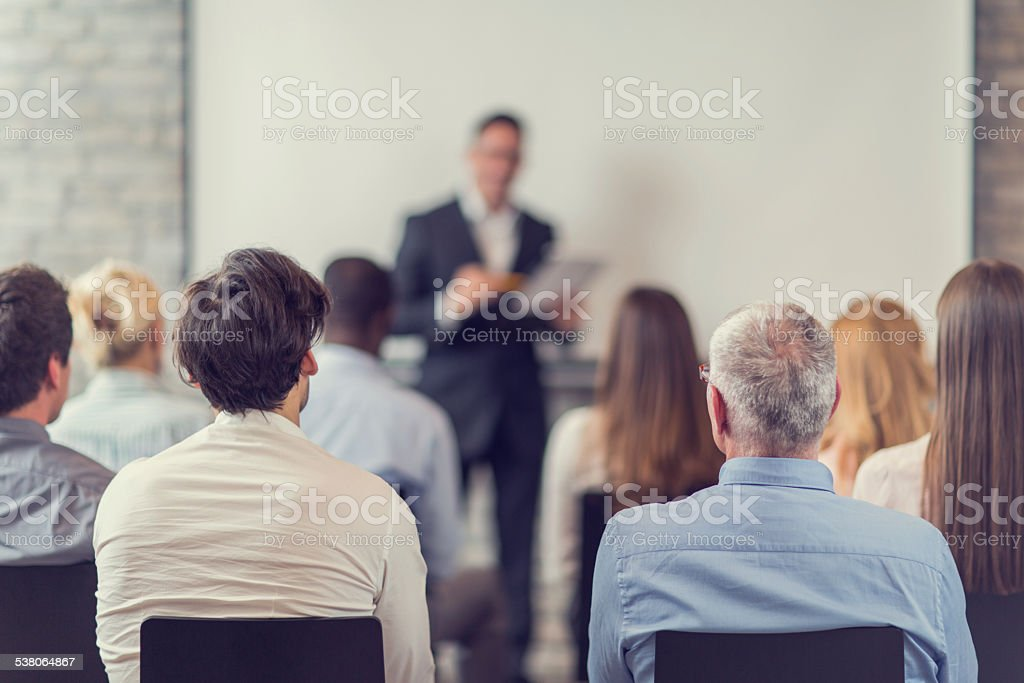 Business people attending a seminar. stock photo