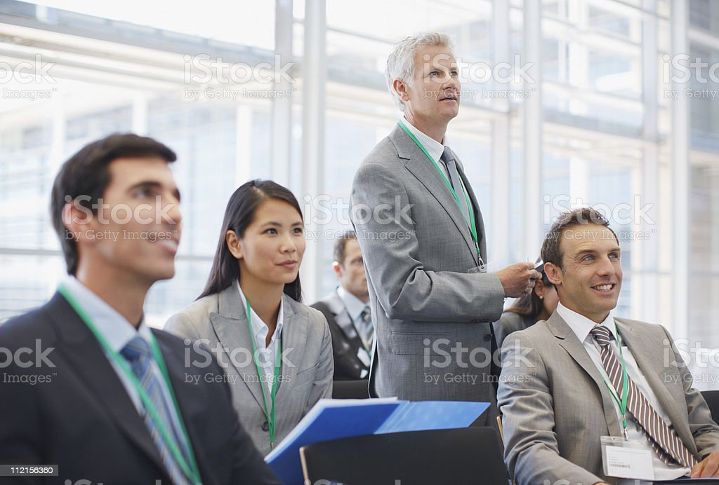 Business people attending seminar in office royalty-free stock photo