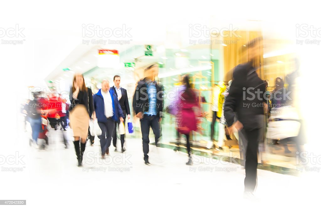 Business people blur. Lots of people walking in modern hall during...