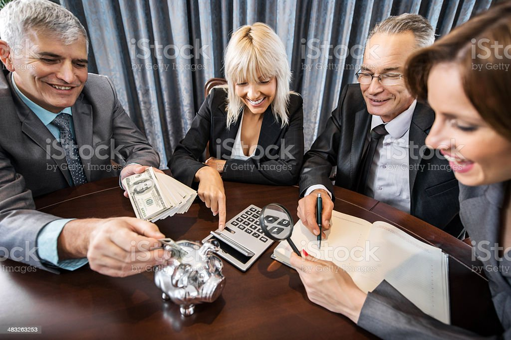 Business people calculating. royalty-free stock photo