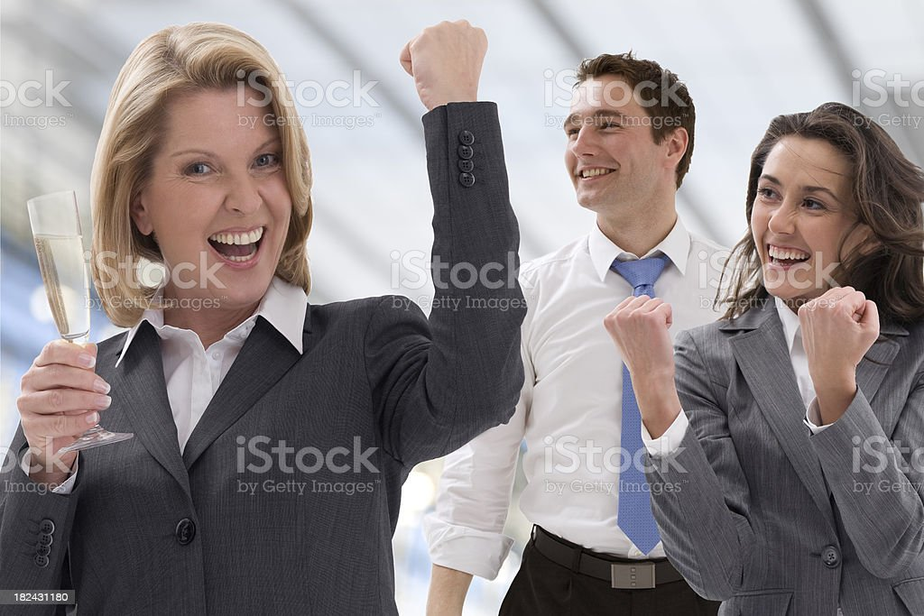 Business people celebrate a victory royalty-free stock photo