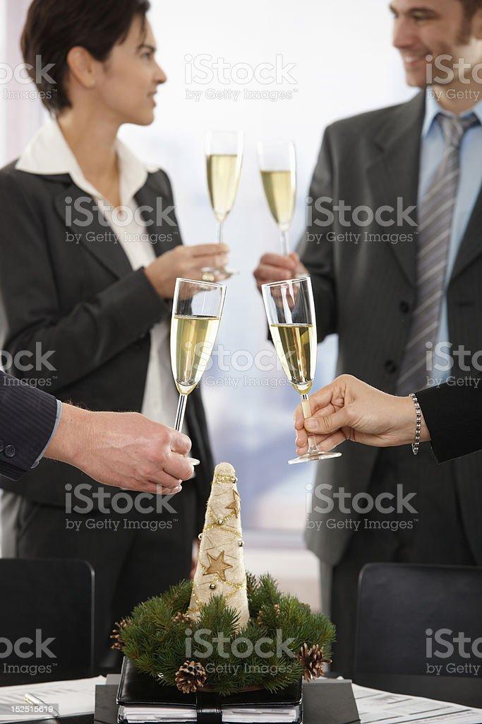 Business people celebrating Christmas royalty-free stock photo