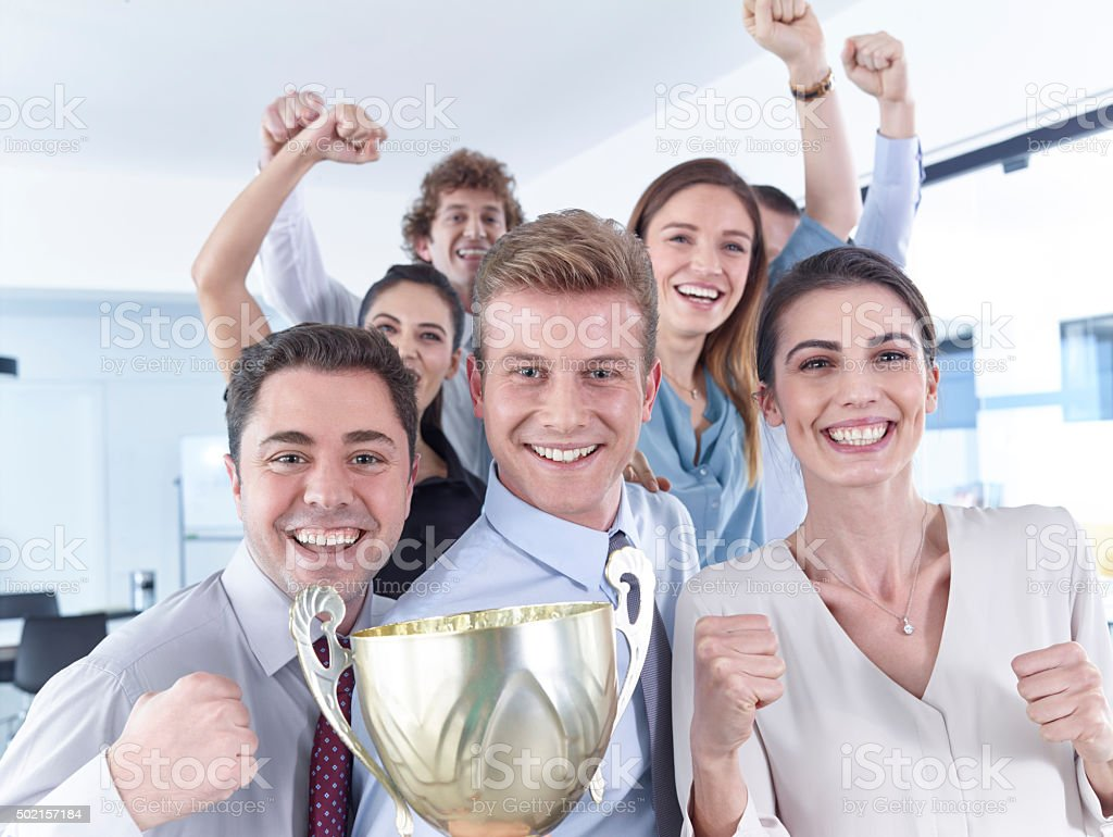 Business people celebrating cup stock photo