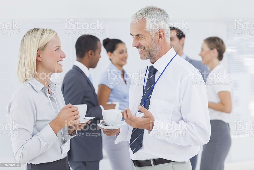 Business people chatting at a conference stock photo