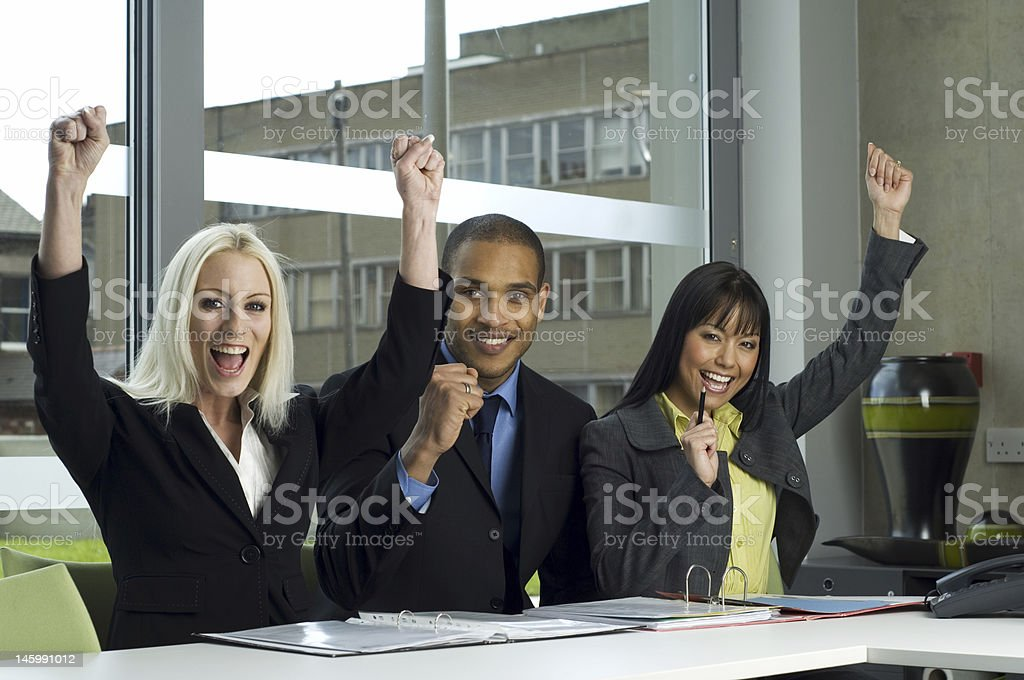 Business people cheering in a meeting royalty-free stock photo