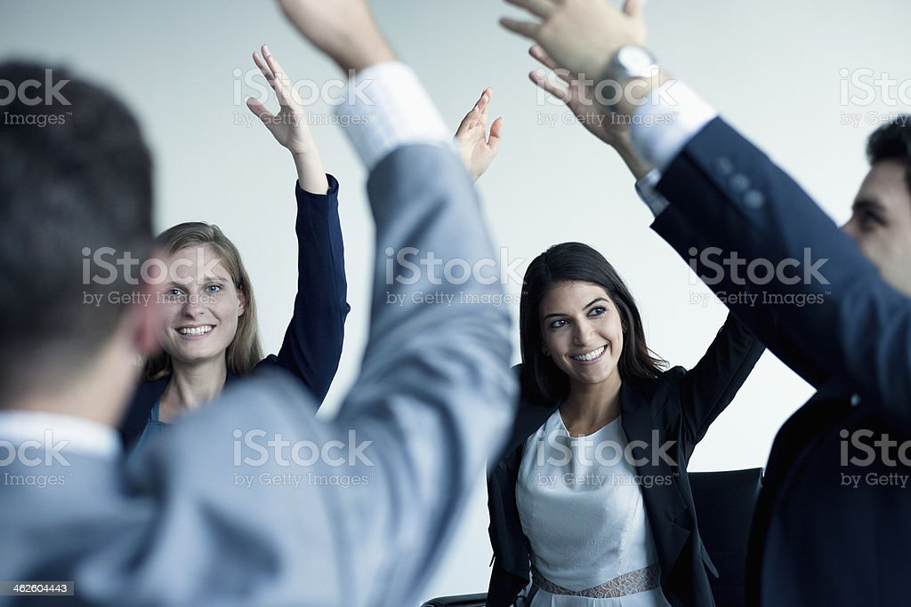 Business people cheering with arms in the air royalty-free stock photo