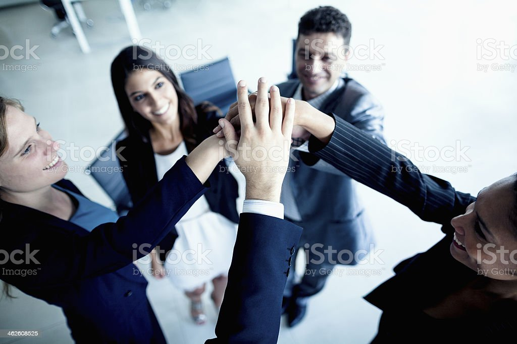 Business people cheering with hands together stock photo
