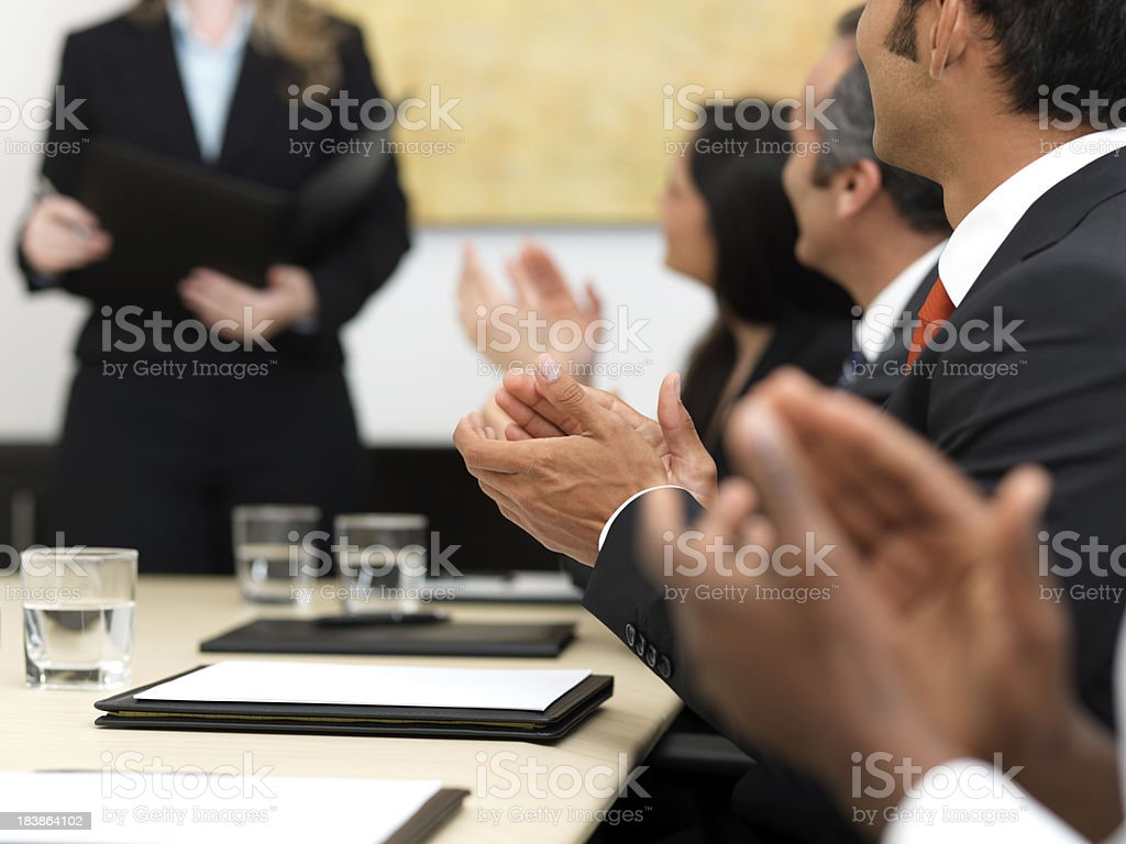 Business people clapping during meeting royalty-free stock photo