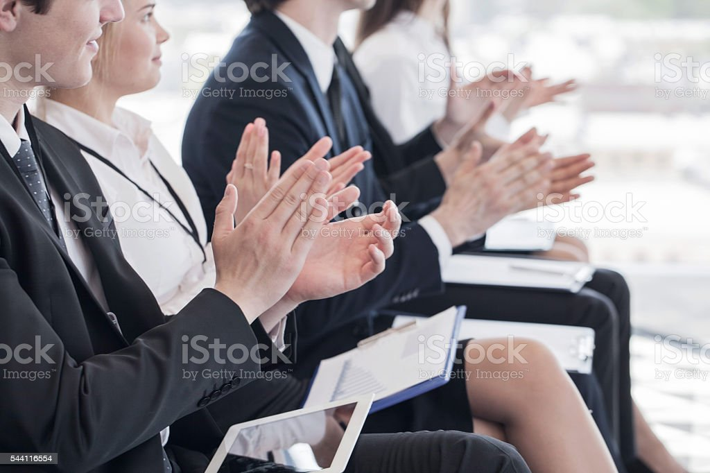 Business people clapping hands stock photo