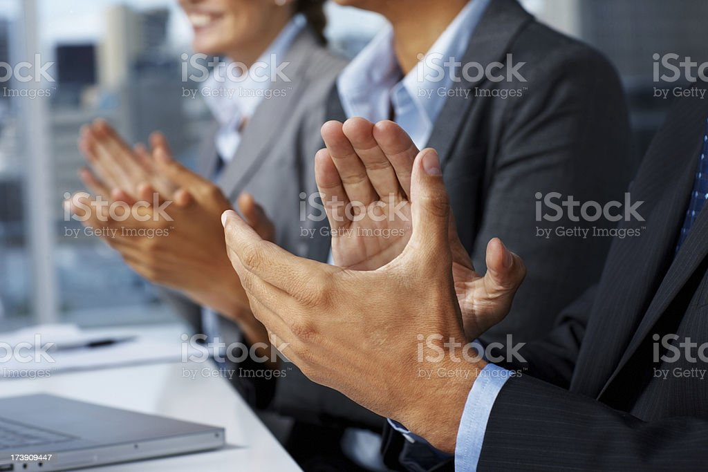 Business people clapping in an office royalty-free stock photo