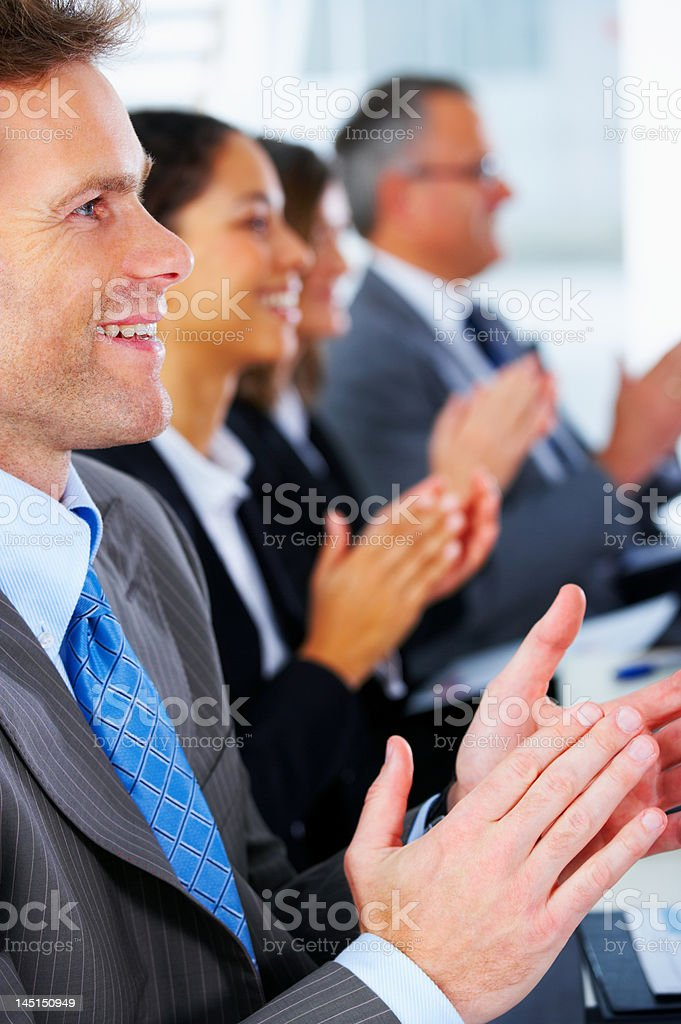 Business people clapping in the conference room royalty-free stock photo