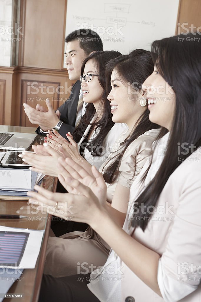 Business people clapping their hands royalty-free stock photo