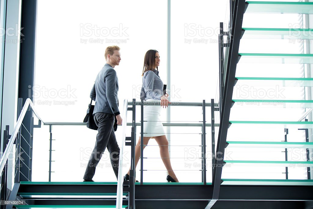 Business people climbing a stairway. stock photo