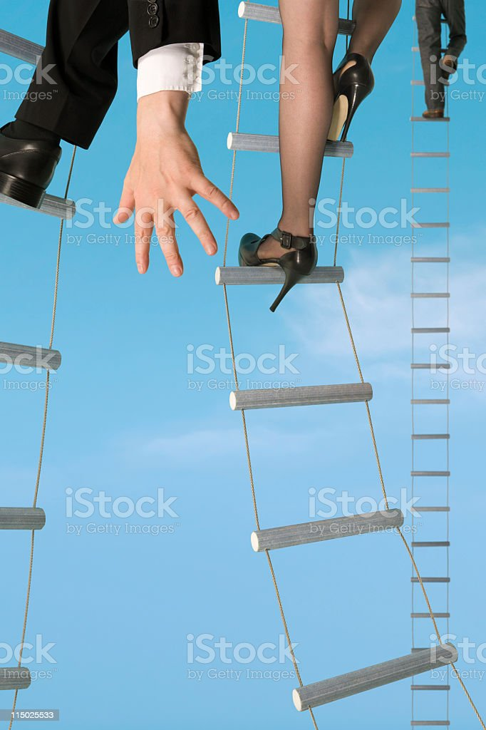 Business people climbing ladders royalty-free stock photo