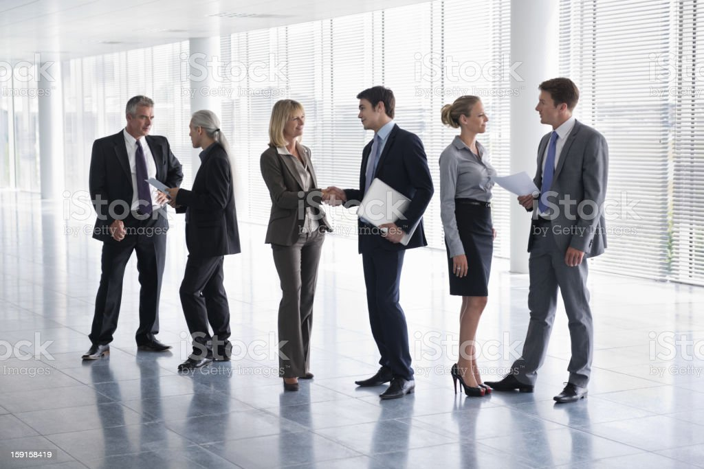 Business People Communicating At Office Lobby royalty-free stock photo