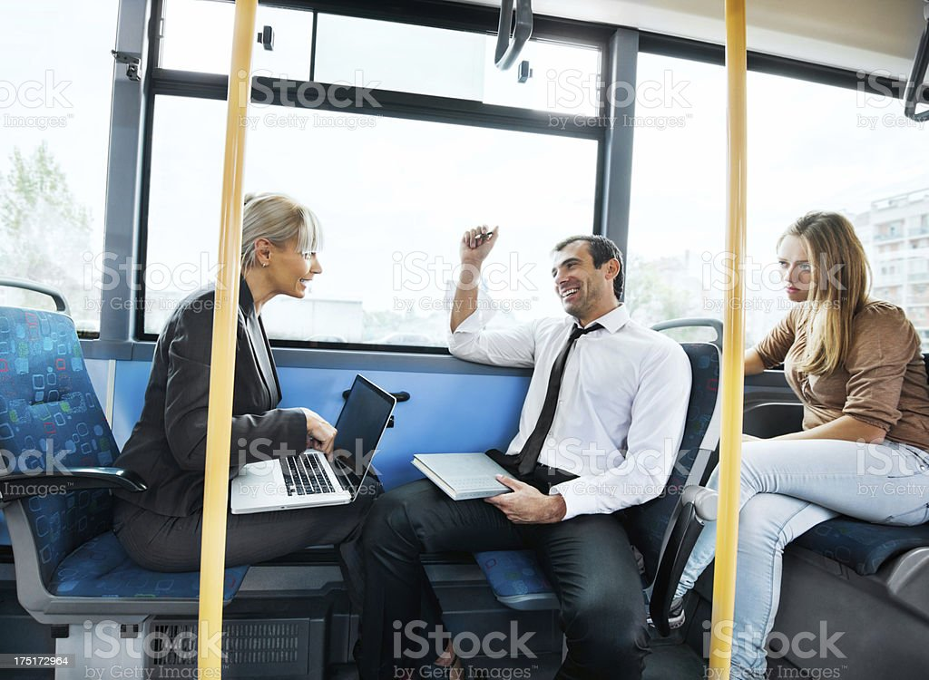Business people communicating while commuting to work royalty-free stock photo