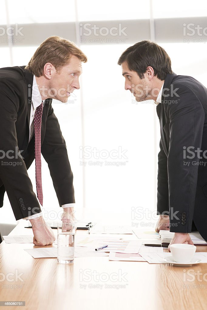 Business people conflicting. stock photo