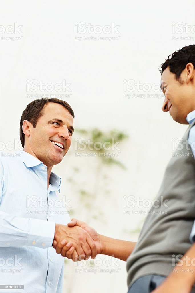 Business people congratulating each other royalty-free stock photo