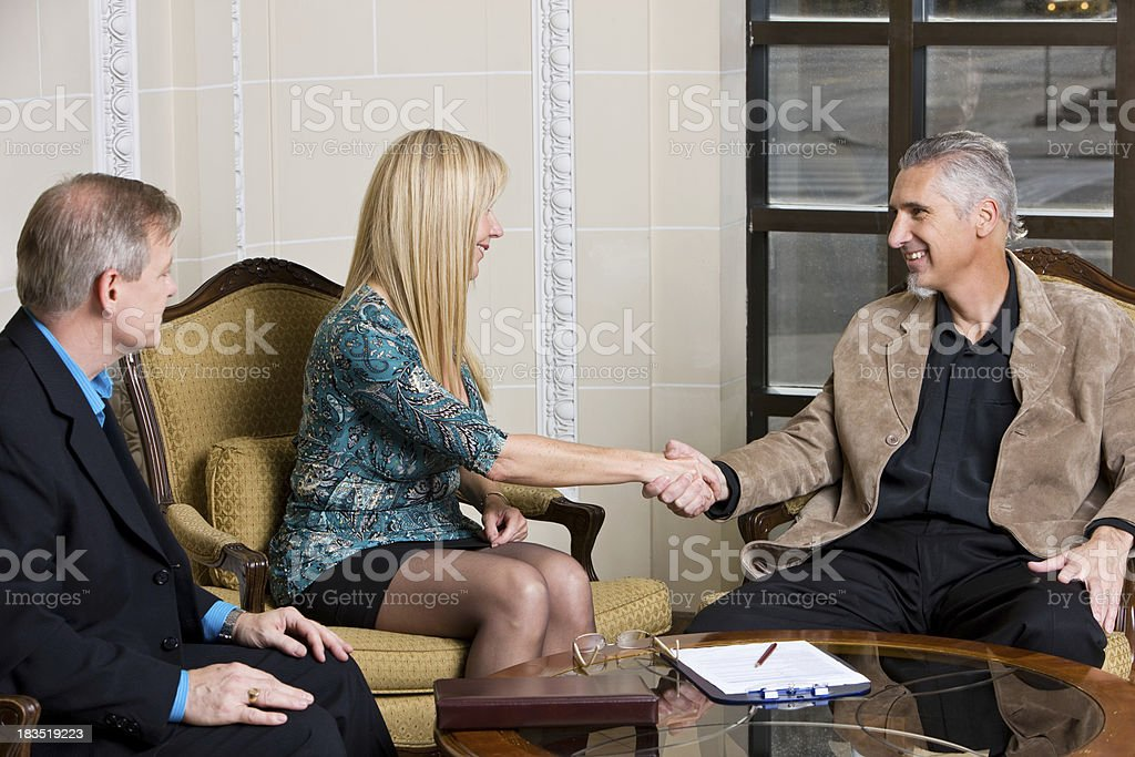 Business People Consumating A Deal royalty-free stock photo