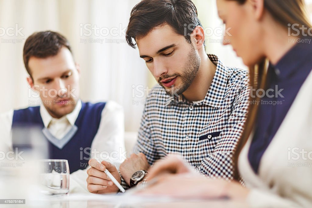 Business people cooperating in the office. stock photo