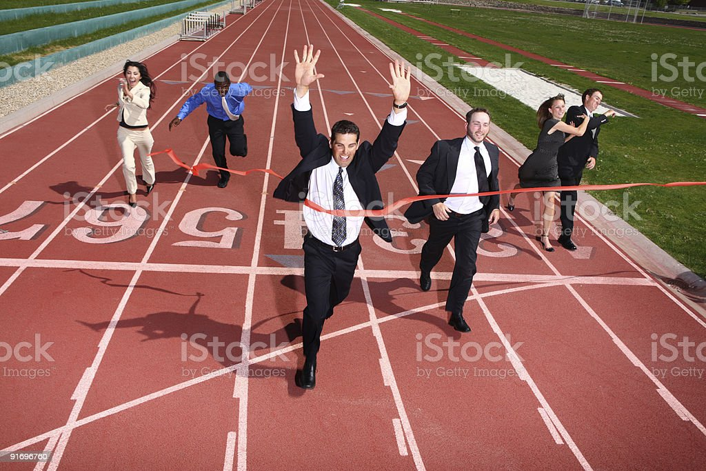 Business people crossing finish line stock photo